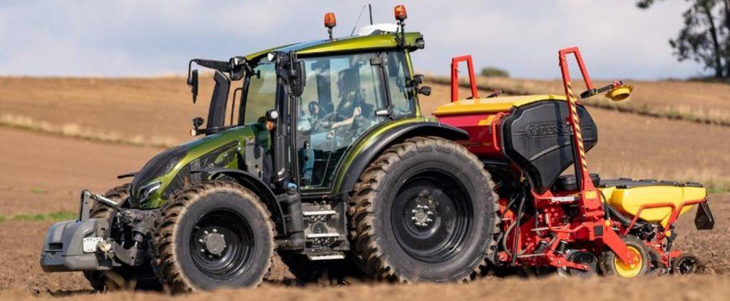 Green Valtra tractor in a farmers field