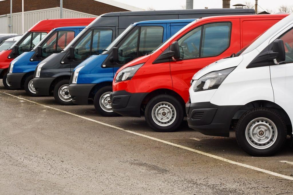 Row of used vans in a car pack